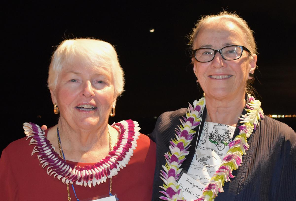 Patricia Lee and Margaret McFall-Ngai in lei