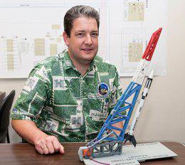 Luke Flynn with model of rocket