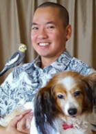 Jason Higa with bird and dog