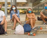 Masked students on the UH Manoa campus
